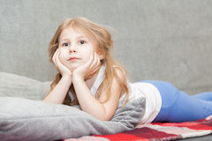 Thoughtful small girl dreaming Stock Photography