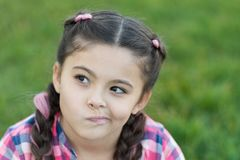 Thoughtful small girl looking for idea what to do. Parks and outdoor. summertime. Small girl with trendy hair. happy royalty free stock photo