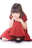 Thoughtful small girl in red dress Royalty Free Stock Images