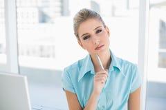 Thoughtful smart businesswoman posing Stock Photos