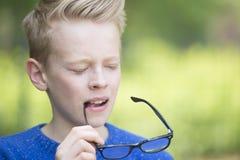 Thoughtful smart teenage boy closed eyes Royalty Free Stock Photos