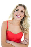 Thoughtful smiling blonde model posing with arms crossed Royalty Free Stock Photos