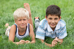 Thoughtful and smiling boys Royalty Free Stock Photography