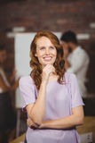 Thoughtful smiling business woman. Thoughtful smiling business women in office Royalty Free Stock Photo