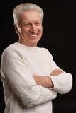 Thoughtful smiling elder man Royalty Free Stock Images