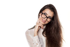 Thoughtful and smiling. Thoughtful smiling girl with eyeglasses posing on a white background stock image