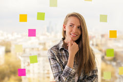 Thoughtful smiling woman Stock Images