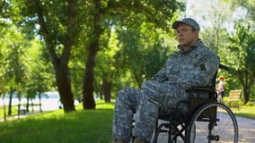 Thoughtful soldier in wheelchair, rehabilitation center, social support program stock video