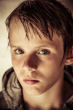 Thoughtful solemn young boy with wet hair Royalty Free Stock Photography