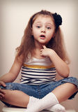 Thoughtful speaking style child looking fun. 4 years old girl Stock Image
