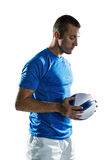 Thoughtful sports player holding ball Stock Images