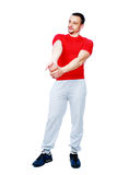 Thoughtful sportsman stretching arms Stock Photo