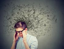 Thoughtful stressed young man with a mess in his head stock photography