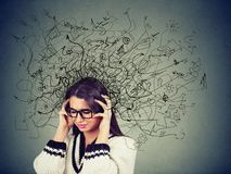 Free Thoughtful Stressed Young Woman In Glasses With A Mess In Her Head Stock Photography - 137886532