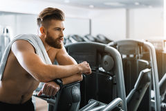 Thoughtful strong man in gymnasium Royalty Free Stock Image