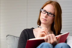 Thoughtful Student with a Book Royalty Free Stock Photography