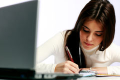 Thoughtful student doing her homework Royalty Free Stock Images