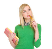 Thoughtful student girl with books Stock Images