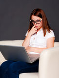 Thoughtful student with laptop Stock Photos