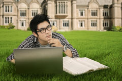 Thoughtful student in the park. Portrait of male high school student studying on the park Royalty Free Stock Photography
