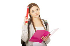 Thoughtful student woman with big pencil. Stock Image