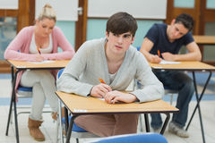 Thoughtful student writing Stock Images