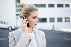 Thoughtful stylish businesswoman having a phone call Stock Image