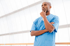 Thoughtful surgeon. Stock Photo