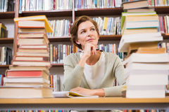 Thoughtful teacher at library Royalty Free Stock Images