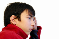 Thoughtful teen. Isolated royalty free stock photography