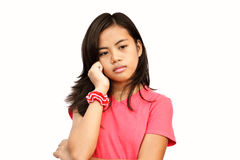 Thoughtful Teen. Asian teenager girl with deep sad thoughts and memories, putting her hand on her chick royalty free stock photo