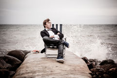 Thoughtful Teen Boy Relaxing at the Seashore Royalty Free Stock Image