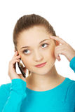 Thoughtful teen with mobile phone. Royalty Free Stock Photography