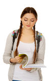 Thoughtful teen woman reading her notebook. Stock Photography