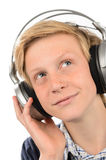 Thoughtful teenage boy listening to music Royalty Free Stock Image