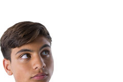 Thoughtful teenage boy looking away. Against white background Royalty Free Stock Photography