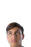 Thoughtful teenage boy looking away. Against white background Royalty Free Stock Photo
