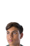 Thoughtful teenage boy looking away. Against white background Stock Image