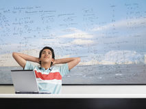Thoughtful Teenage Boy Sitting In Classroom Royalty Free Stock Photos