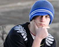 Thoughtful Teenage Boy With Cap Stock Photo