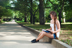 Thoughtful teenage girl with book Stock Photography