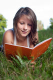 Thoughtful teenage girl with book Royalty Free Stock Photography