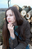 Thoughtful teenage girl on logs Stock Photography