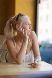 Thoughtful teenage girl looking out the window Royalty Free Stock Image