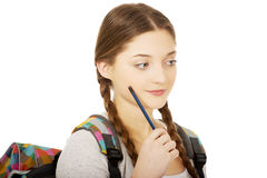 Thoughtful teenage girl with a pen. Royalty Free Stock Image