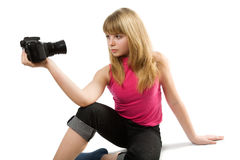 Thoughtful teenage girl with photo camera Royalty Free Stock Photos