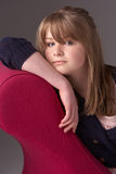 Thoughtful Teenage Girl Relaxing On Chaise Longue Royalty Free Stock Photos