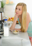 Thoughtful teenager girl having breakfast Royalty Free Stock Image