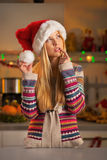 Thoughtful teenager girl in santa hat in christmas Royalty Free Stock Photography