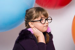 Thoughtful teenager in glasses Royalty Free Stock Images